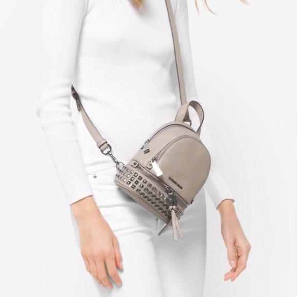d24b72ec0ab4 Michael Kors Mini Rhea Backpack. M_5a9dcf06077b97af26b63e87